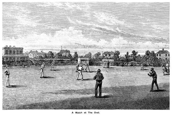 A cricket match taking place at The Oval cricket ground in Kennington, London. The Oval is the home of Surrey County Cricket Club and was the first ground in England to host a test match in 1880. The ground was a market garden until the club was able to persuade the owner