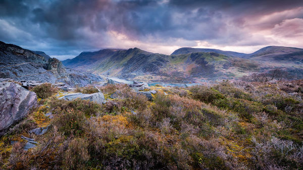 Llanberis, Wales. February 19, 2019. Image shows an extremely wide angle view looking into a deep valley of hills and mountains. In the valley we can see the village of Llanberis