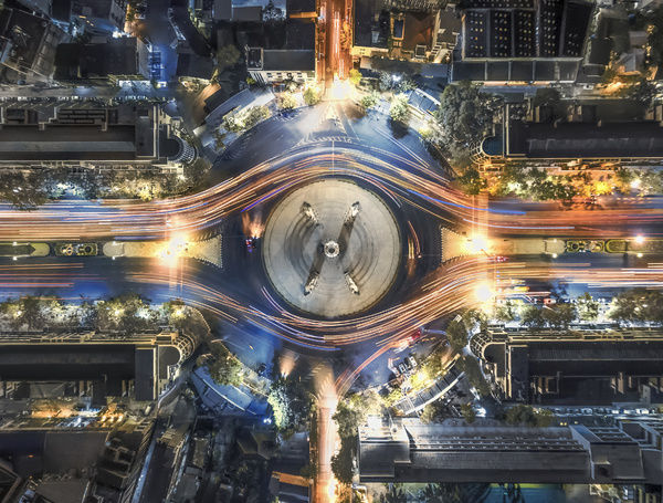 aerial top view traffic circle with speed light in city at night, Democracy Monument, bangkok, thailand