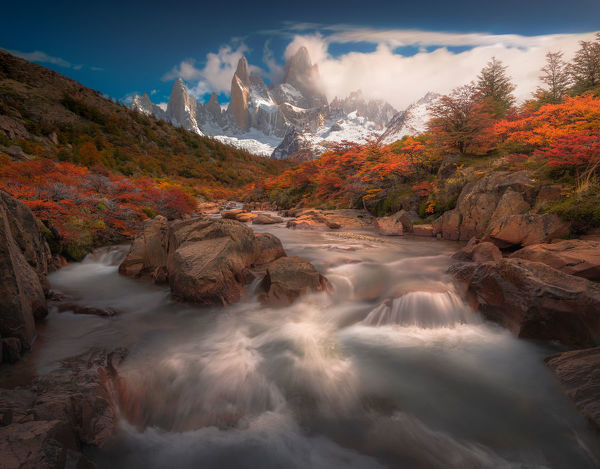 Autumn view of cascade in Patagonia with Mount Fitzroy background
