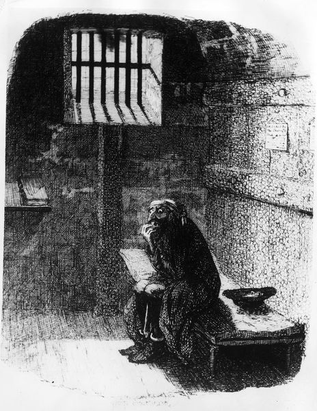 Captured At Last. circa 1838: Fagin sits alone in the condemned cell after