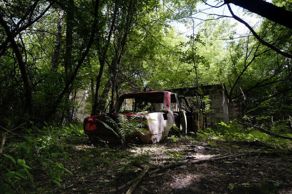 A car stands among abandoned houses in the deserted village of Zalissya located inside the Chernobyl Exclusion Zone in Ukraine on 04 June 2016. The Chernobyl accident occurred on 26 April 1986 at the Chernobyl Nuclear Power Plant in the city of Pripyat