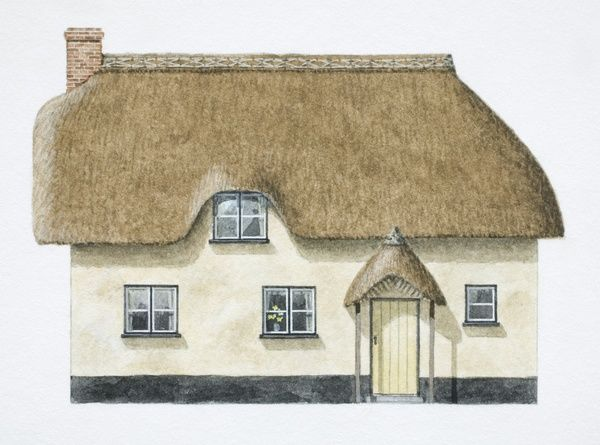Cob cottage with overhanging thatch roof, front view