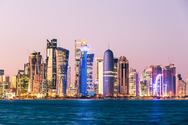 Doha skyline at sunset qatar qatar doha cityscape at sunset doha skyline at sunset qatar altavistaventures Image collections