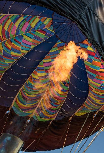 Firing the Balloon. A Helium tank fires, heating the air of hot air balloon in flight
