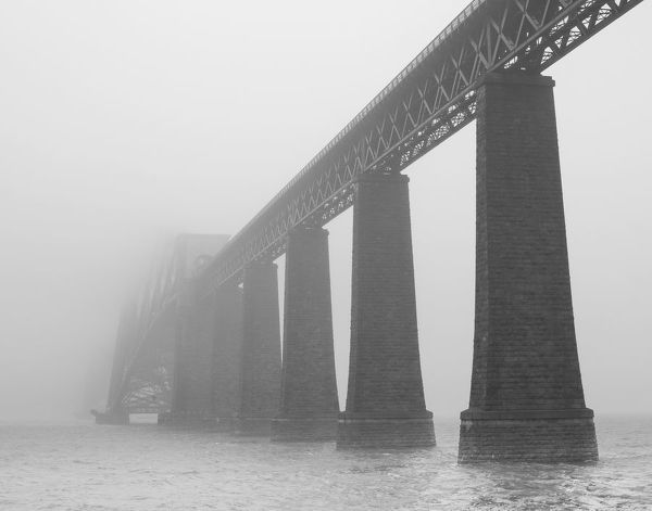 The Forth Rail Bridge - an international icon of engineering - is enveloped by Sea Mist, a common sight on the firth of forth