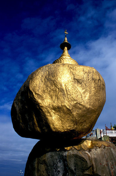 Golden rock against blue sky in Tchaitchio