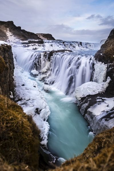 Gullfoss waterfall, with ice and stones, Vik, Iceland