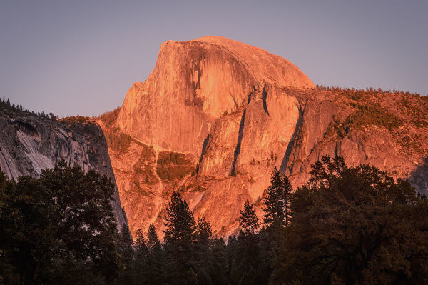 Mountain burn as they call it, a sunset illuminates the face of Half Dome