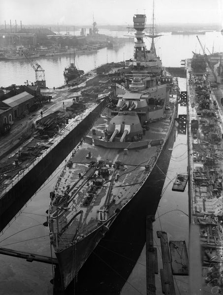 HMS Repulse. December 1929: HMS Repulse in dock showing her fore deck and armaments