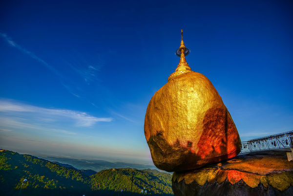 kyaitiyo pagoda also known as Golden Rock) is a well-known Buddhist pilgrimage site in Mon State, Burma. It is a small pagodabuilt on the top of a granite boulder covered with gold leaves pasted on by devotees. According to legend