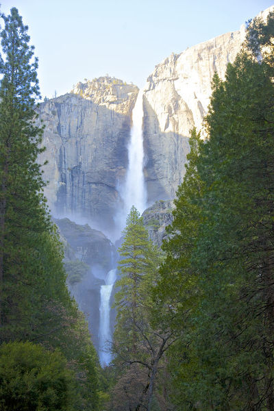 Close up showing multiple plunges of Yosemite Falls at Yosemite Village, Yosemite National Park, California, USA. This is the tallest waterfall in the United States, and the 5th tallest waterfall in the world. Yosemite Creek, which flows over this waterfall