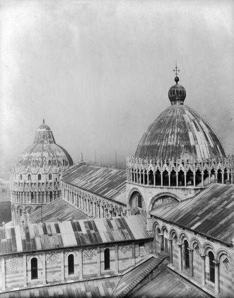 1933: The roof of Pisa cathedral, with the baptistery in the background, as seen from the Leaning Tower. The Romanesque marble cathedral was begun in 1063, and the baptistery nearly a century later in 1153. (Photo by Fox Photos/Getty Images)