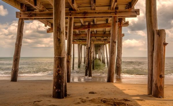 Taken underneath the Nags Head Pier in the middle of day, this is an HDR composite image with minimal enhancement
