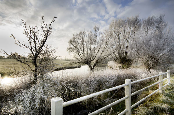 Hoar frost covers all surfaces around the River Thames at Waterhay during a winter flood