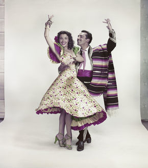 Couple dancing against white background