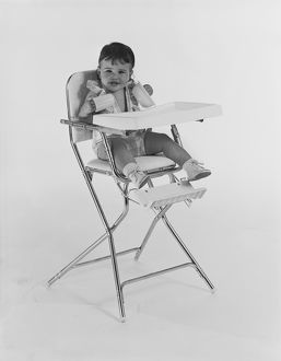 Baby sitting on high chair