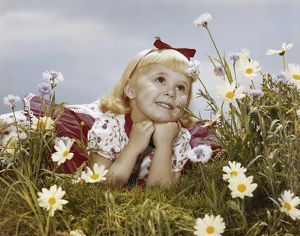 Girl lying in meadow, smiling