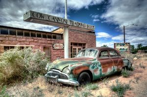 Abandoned 1950's car outside a desert trading post