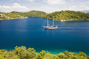 Archipelago with a ssiling ship in the Mljet National Park, Mljet Island, Dubrovnik-Neretva