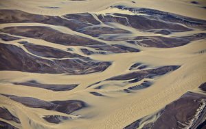 Aerial of muddy glacial riverbed, Iceland