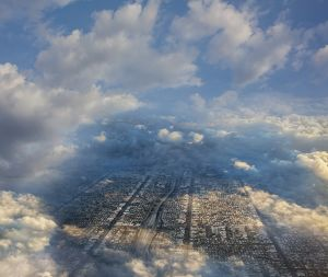 Aerial view of cityscape under clouds