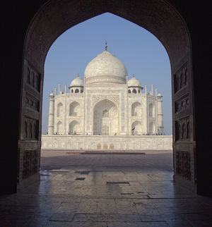 View of Taj Mahal facade through archway