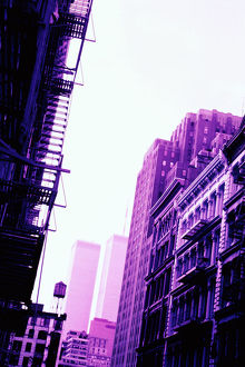 City buildings and fire escape with view of World Trade Center, New York