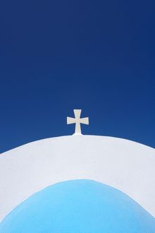 Church dome with cross, Oia, Santorini, Greece