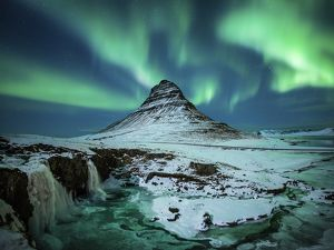 Aurora borealis over Kirkjufell during the night in Iceland