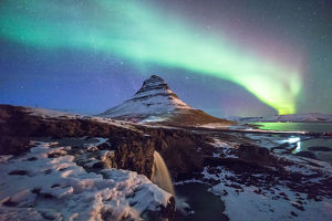 Aurora above mountain Kirkjufell mountain
