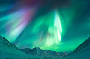 Aurora above mountains