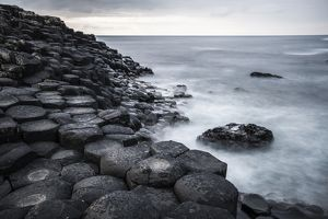 Basaltic rocks on the shore with waves, Giant's Causeway, Coleraine, Northern Ireland