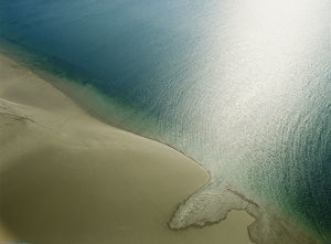 Empty beach and calm sea, aerial view