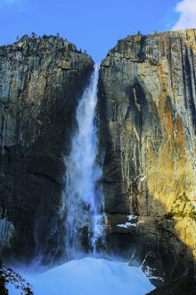 Waterfall over sheer rocky cliffs, Yosemite, California, United States