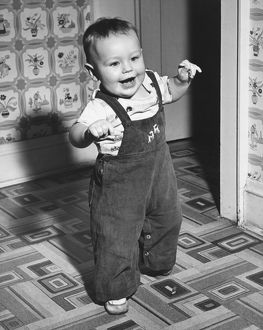 Boy (18-24 months) learning to walk, (B&W)