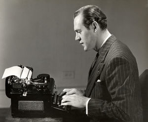 Businessman uses vintage typewriter