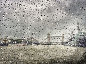 Scenic View Of River And Tower Bridge Seen Through Wet Window