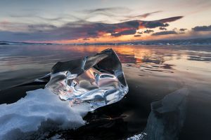 Clear piece of ice at sunset