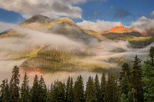 clearing undercast fog at sunrise, alpenglow