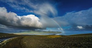 Clouds and rainbow over the seashore, Iceland