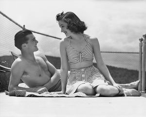 hulton archive/couple relaxing sailboat