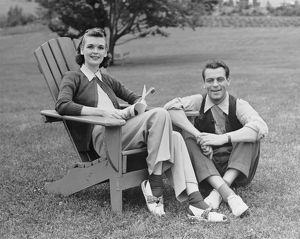 hulton archive/couple sitting outdoors