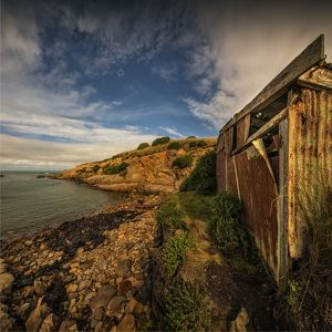 Derelict boat-shed on the coastline at Hillgrove, New Zealand, south island.