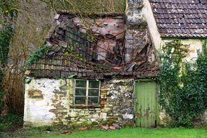 Derelict house with collapsing roof