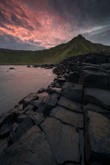 Dramatic sunrise at Giant's Causeway in Northern Ireland