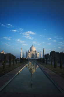 Early morning view of the Taj Mahal with reflection, Agra, Uttar Pradesh, India