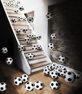 Footballs falling down from staircase
