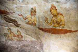 Frescoes depicting bared chested women talking