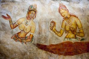 Frescoes depicting two bared chested women talking